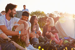 Group Of Friends Relaxing Outside Tents On Camping Holiday Royalty Free Stock Photography