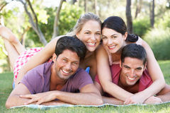 Group Of Friends Relaxing In Park Together Royalty Free Stock Images