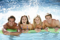 Group Of Friends Relaxing In Swimming Pool Together Royalty Free Stock Photography