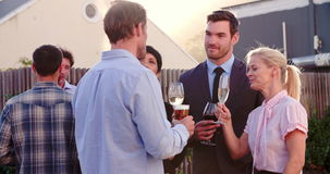 Group Of Friends Relaxing Together At Rooftop Bar stock video footage
