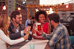 Group of friends at rooftop party Royalty Free Stock Image