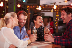 Group of friends at rooftop party Royalty Free Stock Photo