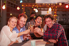 Group of friends at rooftop party Stock Images
