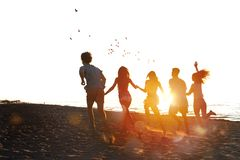 Group of friends run in the sea. Concept of summertime stock image