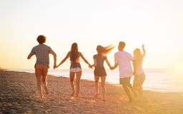 Group of friends run in the sea. Concept of summertime royalty free stock photo