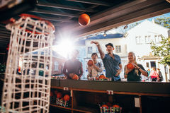 Group of friends shooting hoops at the fair Royalty Free Stock Photography
