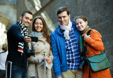 Group of friends shooting mutual portrait on cell phone Royalty Free Stock Image