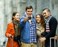 Group of friends shooting mutual portrait on cell phone Stock Photos