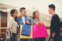 Group Of  Friends Shopping In Mall Together. Group Of Young Friends Shopping In Mall Together Stock Photos