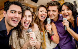Group of friends singing Stock Images