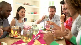 Group Of Friends Sitting Around Table Having Dinner Party stock video