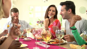 Group Of Friends Sitting Around Table Having Dinner Party stock video footage