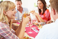 Group Of Friends Sitting Around Table Having Dinner Party Stock Images