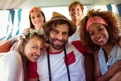 Group of friends sitting in campervan. Group of smiling friends sitting in campervan stock images