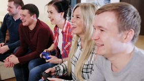 Group of friends sitting on the couch and gaming. Group of friends playing Video Games stock video footage