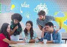 Group of friends sitting in front of idea doodles Stock Photo