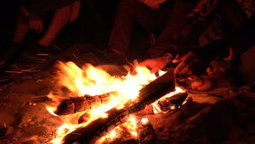 Group of Friends Sitting near Campfire at Night beach and Hanging Out. 4K UHD . Group of Friends Sitting near Campfire at Night beach and Hanging Out. Shot in stock video