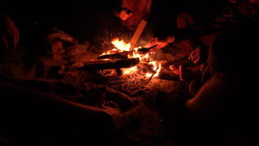 Group of Friends Sitting near Campfire at Night ocean beach and Hanging Out. 4K UHD . Group of Friends Sitting near Campfire at Night ocean beach and Hanging stock video footage