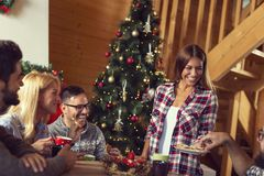Friends eating gingerbread Christmas cookies royalty free stock photography