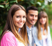 Group of friends sitting outdoor Royalty Free Stock Image