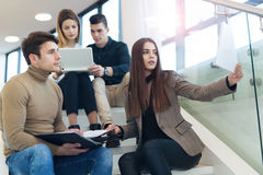 Group of friends sitting on the stairs in the school or college Stock Photo