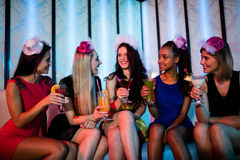 Group of friends sitting together and having mocktail. At bar Royalty Free Stock Photo