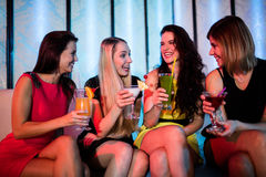 Group of friends sitting together and having mocktail. At bar Stock Photo