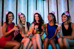 Group of friends sitting together and having mocktail. Portrait of friends sitting together and having mocktail at bar Royalty Free Stock Photography