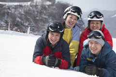 Group of Friends in Ski Resort, Smiling and Looking at Camera Royalty Free Stock Images