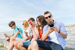 Group of friends with smartphone outdoors Royalty Free Stock Image