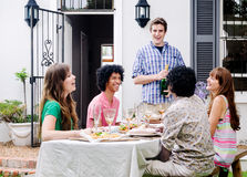 Group of friends smiling and laughing Stock Images