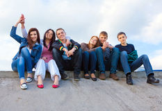 Group of friends smiling outdoors Royalty Free Stock Images