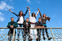 Group of friends smiling outdoors Royalty Free Stock Image