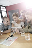Group of friends in a snack bar websurfing Royalty Free Stock Image