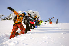 Group of friends snowboarders having fun on the top of mountain Stock Photography