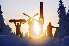 Group of friends snowboarders having fun on the top of mountain Stock Photo