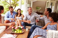 Group of friends socialising in a conservatory stock photography