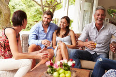 Group of friends socialising in a conservatory Stock Photo