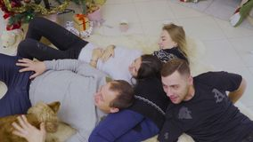 A group of friends spend their time together at home stock video