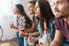 Group of friends sport fans watching soccer match interesting game royalty free stock image