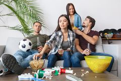 Group of friends sport fans watching soccer match junk food stock image