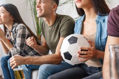 Group of friends sport fans watching soccer match support close-up stock photo
