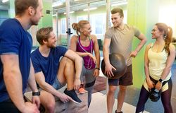 Group of friends with sports equipment in gym Royalty Free Stock Images