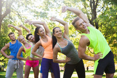 Group of friends or sportsmen exercising outdoors Royalty Free Stock Photo
