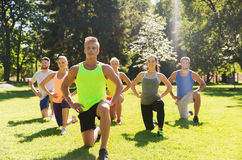 Group of friends or sportsmen exercising outdoors Royalty Free Stock Photos