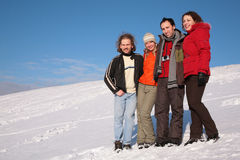 Group of friends stand on snow Stock Photos