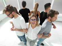 Group of friends standing in a circle. The concept of teamwork Stock Images