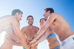 Group of friends standing in circle hands together. At the beach Stock Images