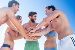 Group of friends standing in circle hands together. At the beach Stock Photos