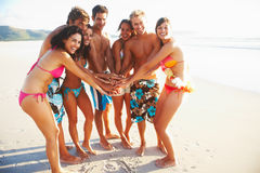Group of friends standing with hands togethee Royalty Free Stock Photo